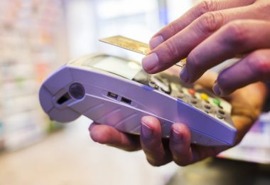 Male Close-up electronic payment hand cell phone market