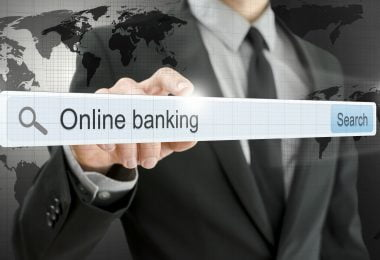 Online banking written in search bar on virtual screen. Elements of this image furnished by NASA.