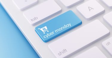 High quality 3d render of a modern keyboard with blue cyber monday button on a blue background and copy space. Blue cyber monday keyboard button has a text  and an icon on it. Cyber monday keyboard button is  in focus, Horizontal composition with copy space.